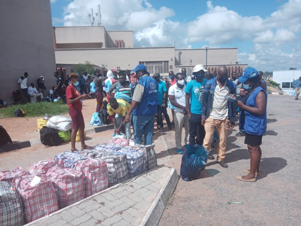 COVID-19 affected returning migrants receive post arrival support