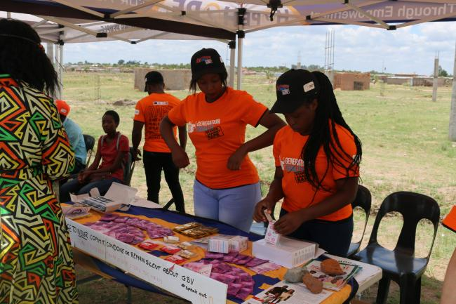 Service providers disseminating information at the launch of one-stop center campaigns